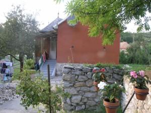 Huis vanaf het kleine terras
